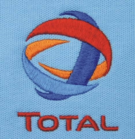 A close up view of a stiched logo on a cotton top